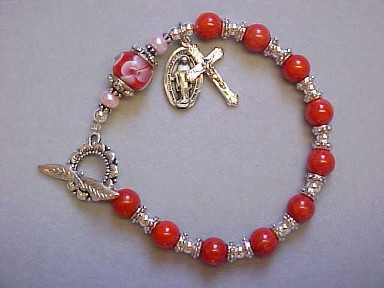Rosary Bracelet with Red Coral, floral lampwork glass, Silver Plated sunflower clasp with crucifix and miraculous medal dangles