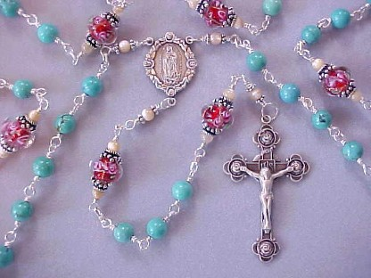 Genuine turquoise gemstone rosary with hand made red glass with pink roses, all sterling wire wrapped construction, sterling silver crucifix and Our Lady of Guadalupe center medal