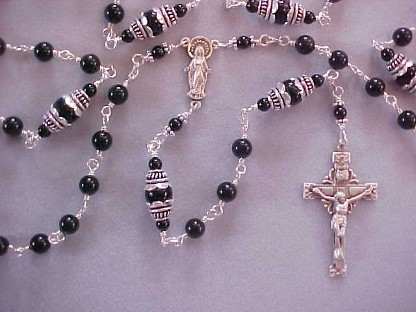 Sterling silver rosary with 6 & 8mmblack rainbowed obsidian, tulip caps, our lady figural center and starburst crucifix