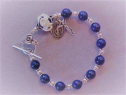 beaded sterling silver rosary bracelet with 8mm Lapis Lazuli and matching 10x13mm Cameo Rose Our Father, double rose clasp and small crucifix and medal dangles