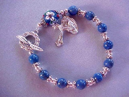 rosary bracelet with denim lapis and floral lampworked glass