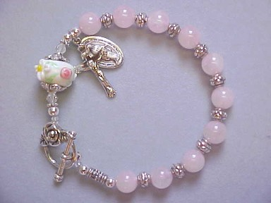 rosary bracelet with rose quartz and lampworked glass with roses and daisies
