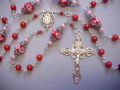Red Coral rosary with red lampworked glass with pink flowers, capped in Bali Silver, sterling silver wire wrapped