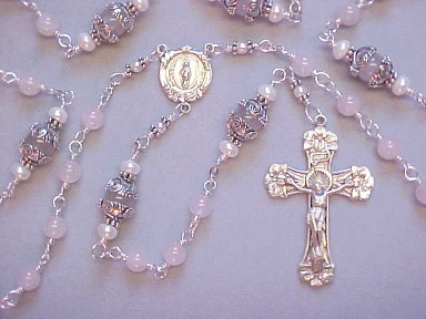 Rose Quartz Rosary with sterling silver crucifix, miraculous medal center, all sterling wire wrapped construction