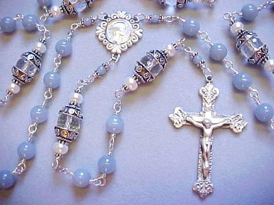 handmade sterling silver wire wrapped rosary with angelite gemstone, rock crystal gemstone and button pearls
