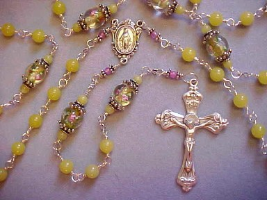 handmade sterling silver wire wrapped rosary with Peridot jade and lampworked glass