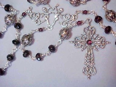 rare museum quality rosary with garnet rondelles capped in Bali Silver, ornate filigree Bali Silver Our Fathers, Elaborate Renaissance design sterling silver cross with garnet stone and cherubs center, all sterling wire wrapped construction
