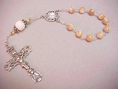 handmade single decade rosary with mother of pearl and carved clamshell, wire wrapped in sterling silver with deluxe sterling silver crucifix and center