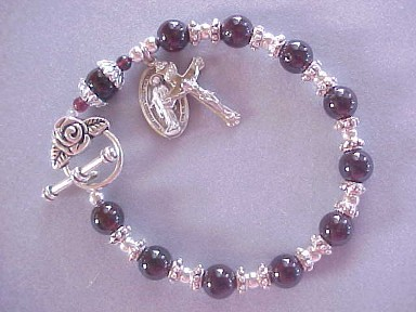 handmade rosary bracelet with genuine garnet gemstones, crucifix and medal dangles, rose toggle clasp