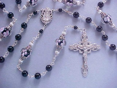 Black Tourmaline handmade rosary with lampworked floral glass. All sterling silver wire wrapped construction