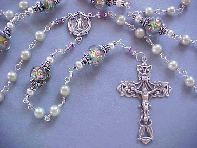 Sterling Silver wire wrapped rosary with pistachio pearls and lampworked glass.